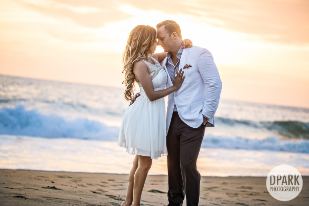 The beautiful couple in love; with the luscious waters of Montage Laguna Beach behind them.